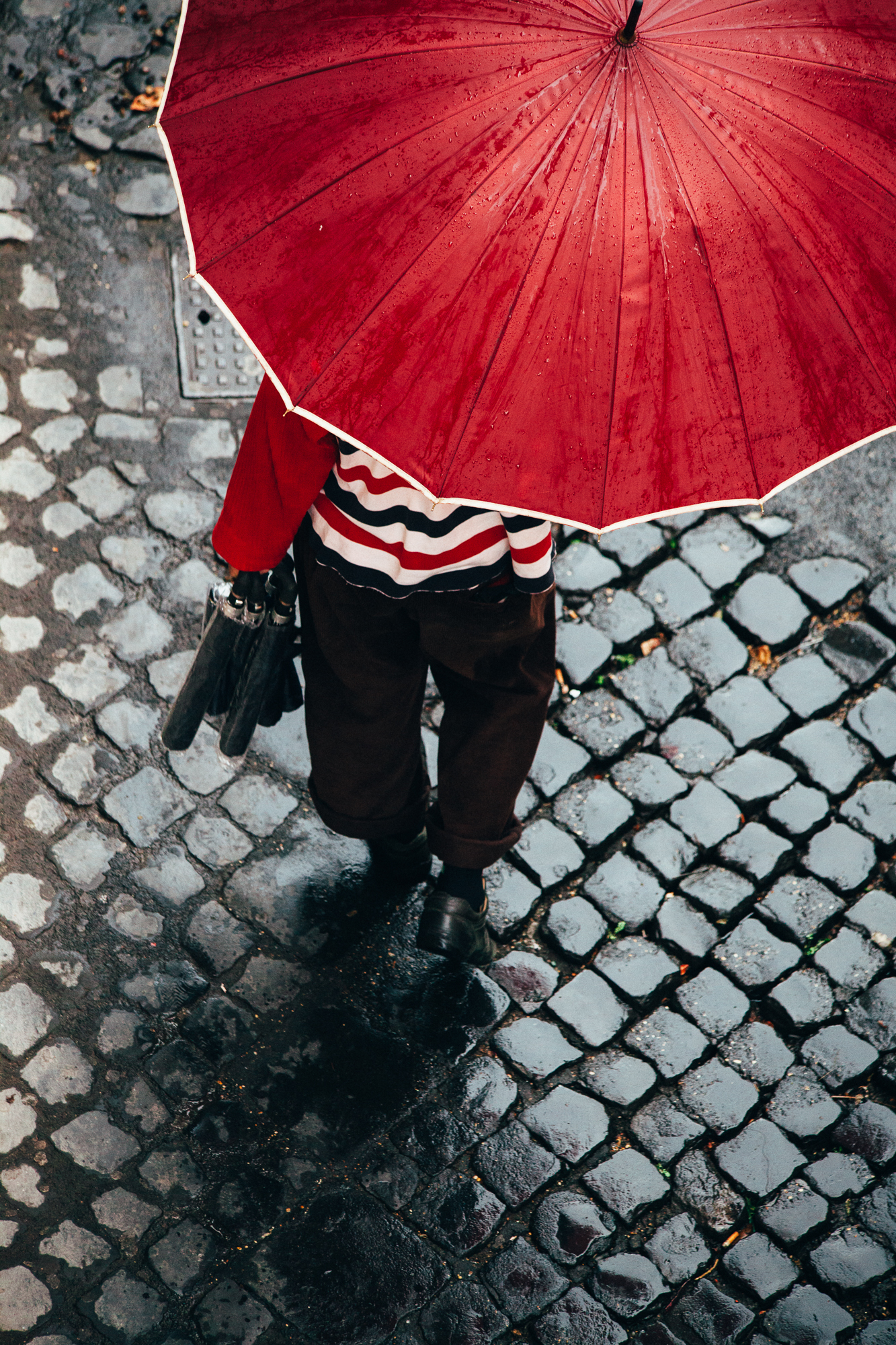 umbrella seller, rome. by leonie wise