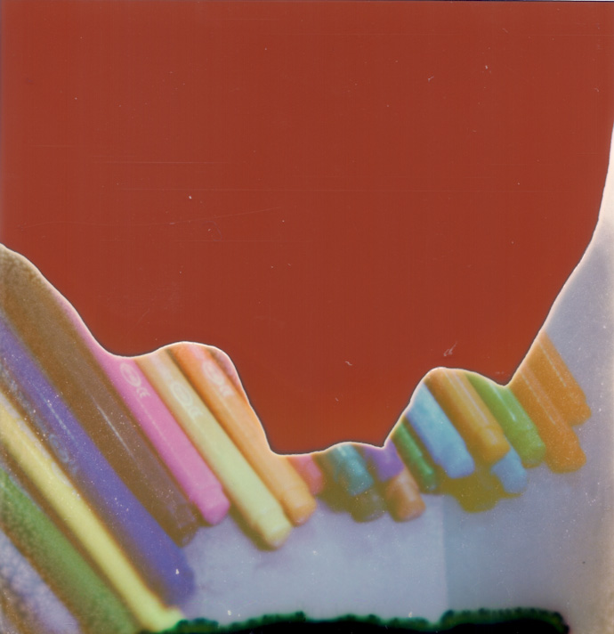 polaroid photograph of coloured pens. copyright leonie wise