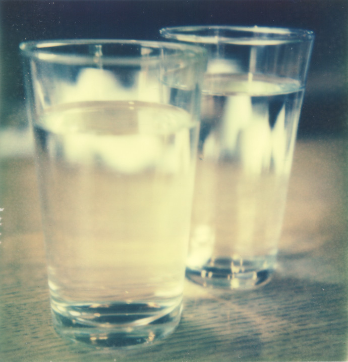 polaroid photograph of two glasses of water. copyright leonie wise