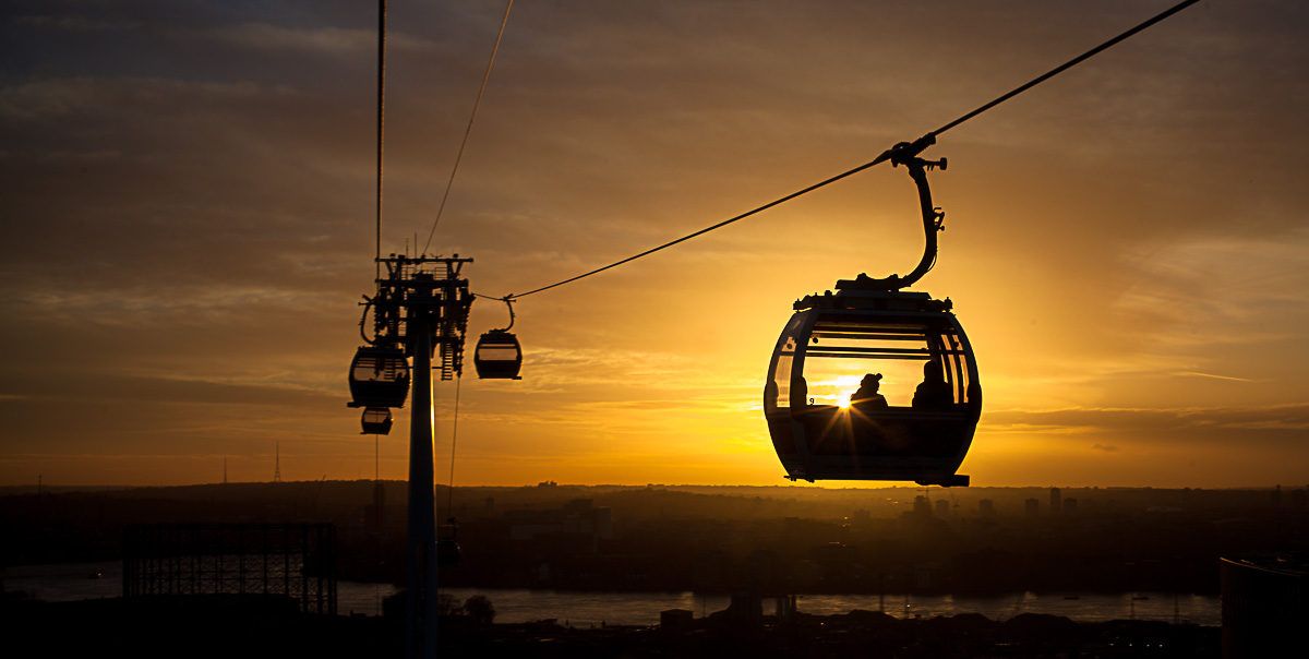 london's emirates air line - as seen from inside a gondola. sunset. copyright leonie wise