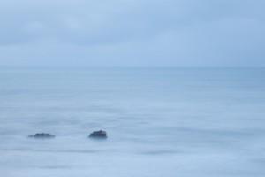 long exposure of rocks in the ocean. copyright leonie wise