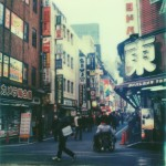 polaroid photograph of a street in shinjuku, tokyo, japan. copyright leonie wise. all rights reserved