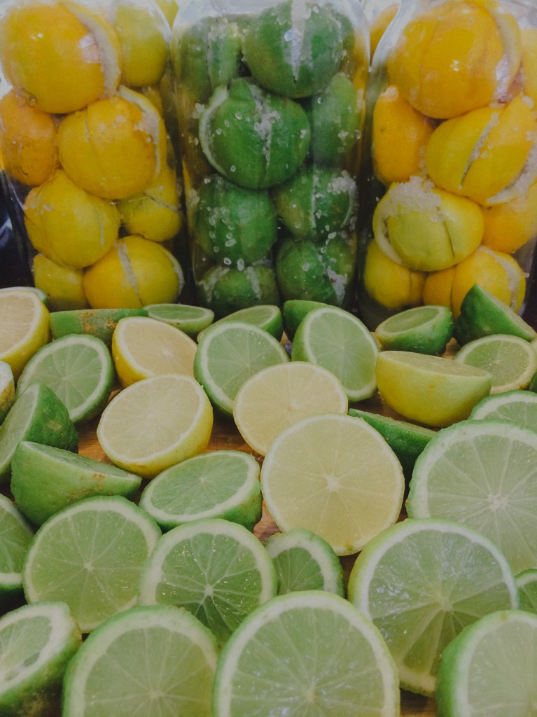 Lemons and Limes being packed in salt and preserved. Copyright Leonie Wise