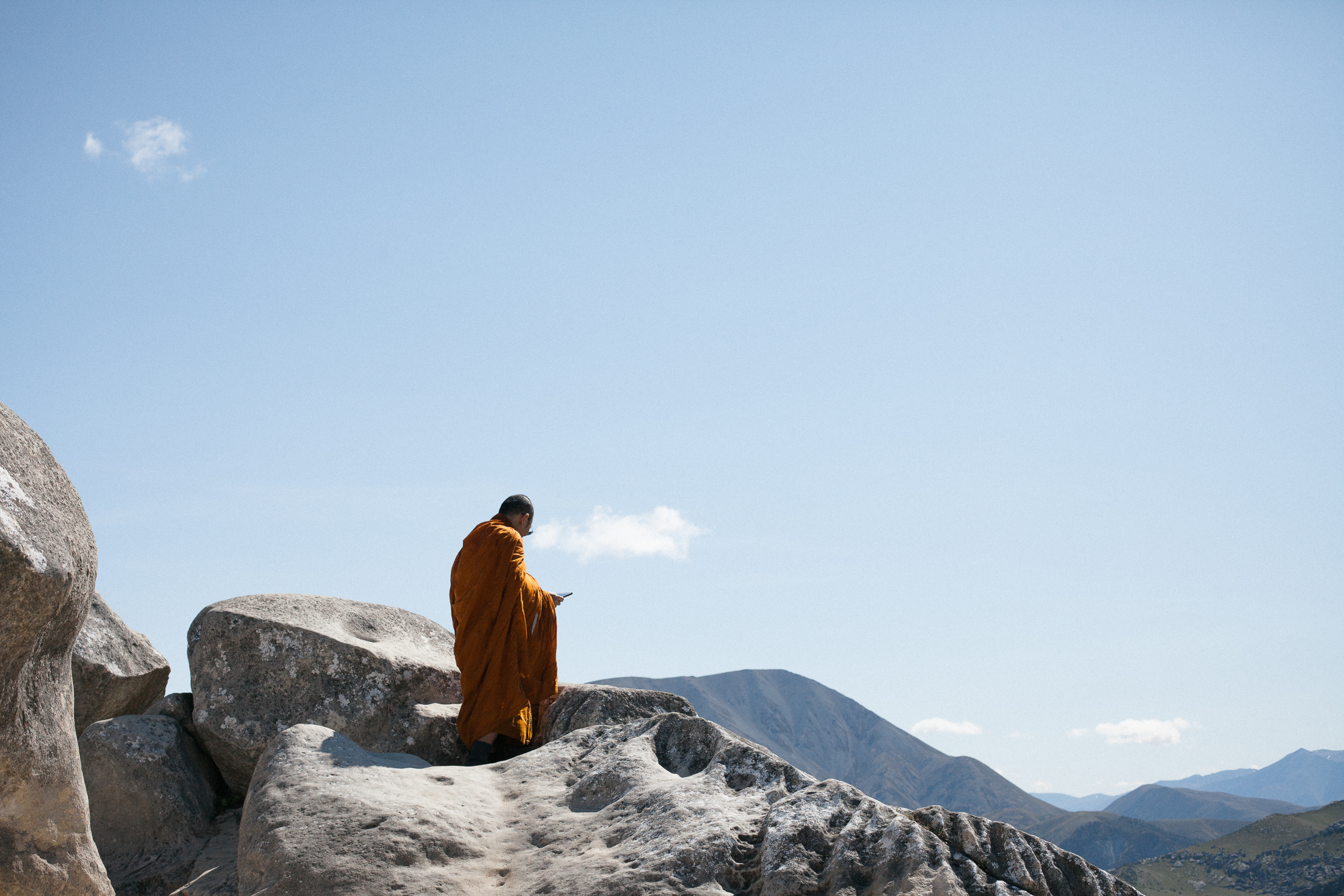 monk with an ipad on castle hill. copyright leonie wise