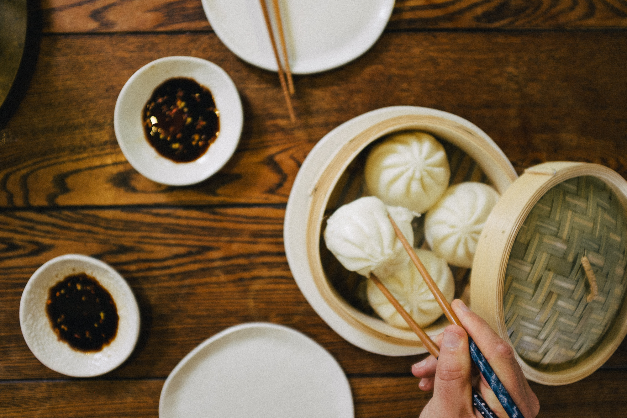 steamed buns on the table. by leonie wise