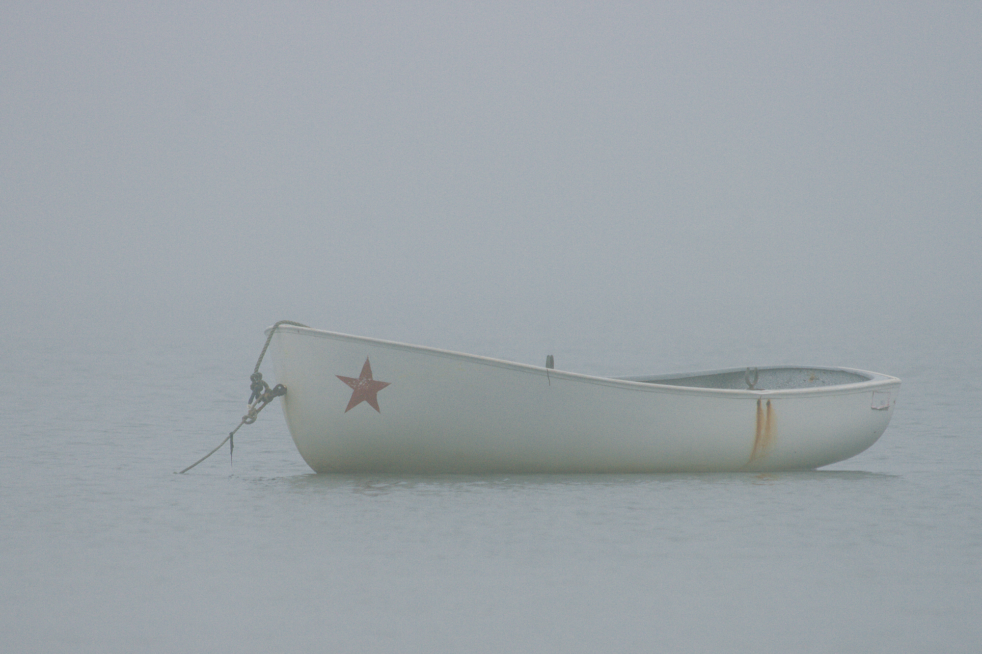 a boat in the fog, provincetown, usa. by leonie wise