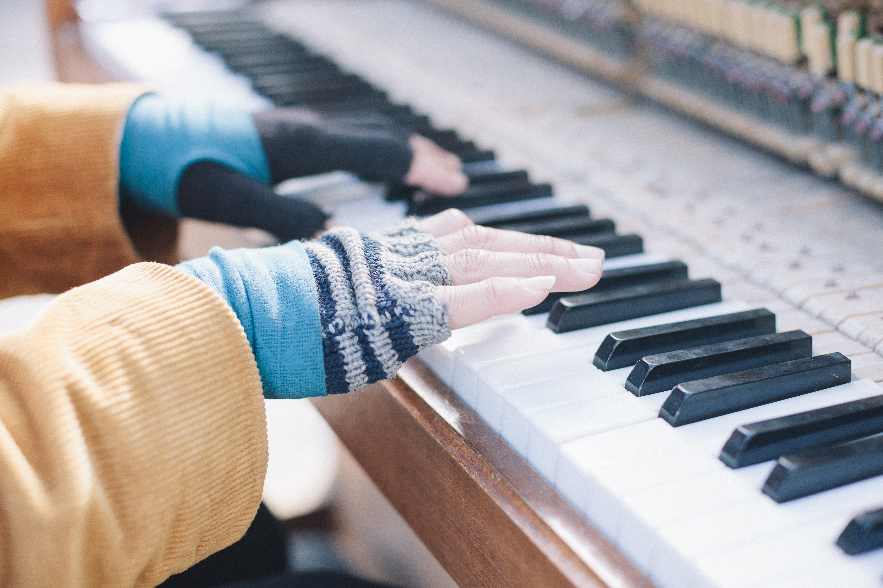 hands playing the piano. by leonie wise